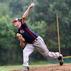 DAVID LE/Staff photo. Swampscott starting pitcher ____ Howard fires a pitch against Masco. 7/18/16.