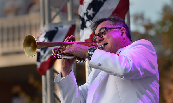 """First trumpet of the Hillyer Festival Orchestra Jeff Hogffler performs """"TrumpetLullabye"""" during the 4th of July concert.<br /> <br /> Photo by joebrownphotos.com"""