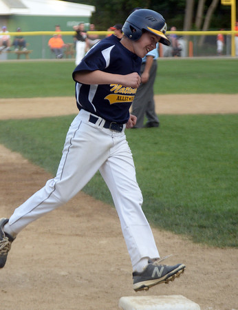CARL RUSSO/Staff photo. Andover National, Nick Saunders rounds third base after hitting a home run. Andover defeated Woburn 16-6 in Little League action. 7/20/2016