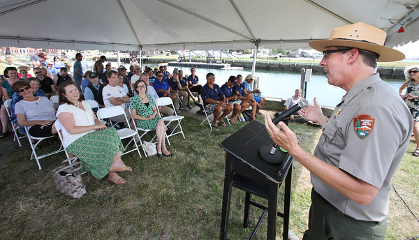 KEN YUSZKUS/Staff photo.   Salem Maritime National Historic Site superintendent Paul DePrey speaks to the assembled crowd after the Hokule'a arrived at Central Wharf in Salem during it's global journey.  07/14/16