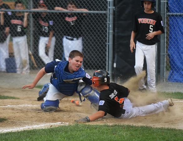 CARL RUSSO/Staff photo. Andover National catch, Owen Christopher puts the tag for the out on Woburn's Jonathan Surrette. Andover defeated Woburn 16-6 in Little League action. 7/20/2016