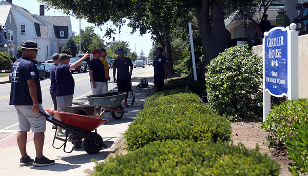 DAVID LE/Staff photo. Twenty-five Navy Seals with the assistant of Habitat for Humanity did some landscaping at the Girdler House on Lothrop Street in Beverly on Friday afternoon. 7/22/16.