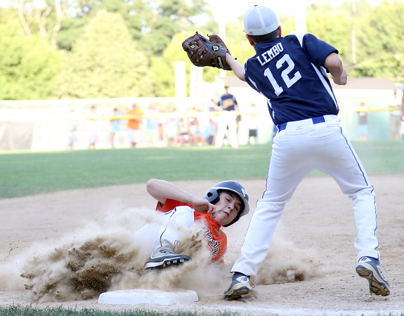 DAVID LE/Staff photo. Beverly's Joey Loreti slides safely into third after advancing on a fielder's choice. 7/21/16.