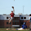 DAVID LE/Staff photo. Newburyport second baseman Quin Stott leaps high in the air and over sliding Middleton-Peabody runner Nick Colucci (15) and tries to grab a high throw from the catcher on a steal. 7/19/16.