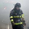 PAUL BILODEAU/Staff photo. Firefighters battle a fast moving, multi-alarm fire on Bay View Drive in Swampscott.