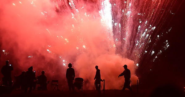 Bombadiers and Salem Firefighters are silhouetted by the fireworks on Derby Wharf.<br /> <br /> Photo  by joebrownphotos.com