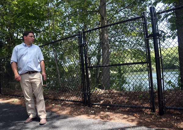 DAVID LE/Staff photo.Brendan Callahan, of the City of Peabody Community Development Office, discusses some of the renovations done to the Spring Pond Trail. 7/27/16.