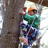 DAVID LE/Staff photo. O'Maley rising 6th grader Samantha Figueiredo climbs up a tree at Project Adventure in Beverly on Friday afternoon. 7/22/16.