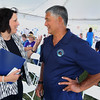 KEN YUSZKUS/Staff photo.   Salem Mayor Kim Driscoll speaks with Hokule'a captain Bruce Blankenfield before the start of the program welcoming him and his crew to Salem. The Hokule'a docked at Central Wharf in Salem during it's global journey.  07/14/16