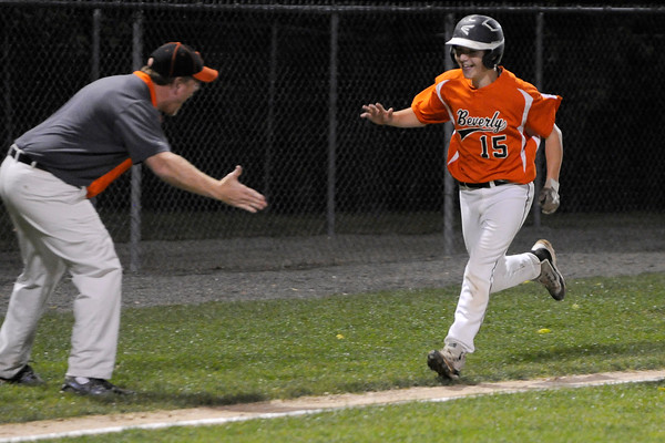TIM JEAN/Staff photo<br /> Beverly's Joey Loreti rounds third base and is congratulated by his coach after hitting a home run againt Andover during the Section 4 Little League all-star championship game.  7/23/16