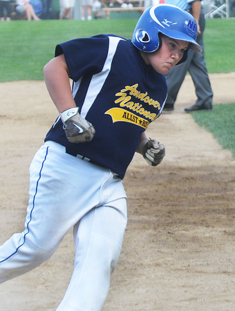 CARL RUSSO/Staff photo. Andover National catch, Owen Christopher rounds third base after hitting a home run. Andover defeated Woburn 16-6 in Little League action. 7/20/2016