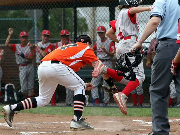 DAVID LE/Staff photo. On a very controversial call at home plate the Pittsfield American runner gets tagged out by Beverly first baseman Nick Fox, while also appearing to miss touching the plate. 7/28/16.