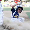 DAVID LE/Staff photo. Andover National leadoff hitter Brian Gibson slides safely into third as he advanced from first to third. 7/21/16.