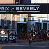 DAVID LE/Staff photo. A couple riders in the Beverly Gran Prix cross through a bright patch of sunlight while crossing the finish line. 7/27/16.