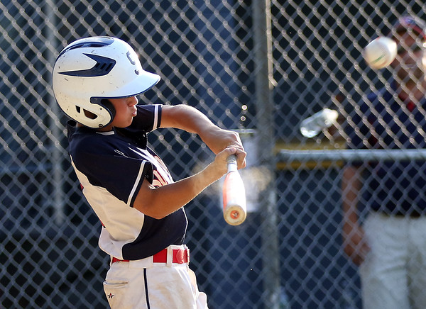 DAVID LE/Staff photo. Swampscott's Connor Correnti launches a go-ahead 3-run homer against Peabody West in the District 16 Championship on Friday evening. 7/15/16.