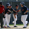 DAVID LE/Staff photo. Peabody West first baseman Tyler Fawcett is greeted at home plate after launching a solo homer against Swampscott. 7/15/16.
