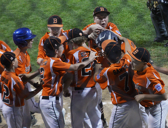 CARL RUSSO/Staff photo. Beverly's, Joey Loreti is congratulated by his teammates after hitting a home run in Little League action against Swampscott. 7/20/2016