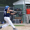 DAVID LE/Staff photo. Andover National first baseman Owen Christopher launches a grand slam to deep right field against Beverly. 7/21/16.