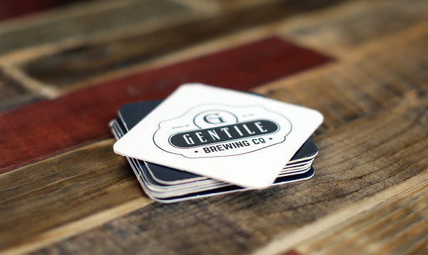 DAVID LE/Staff photo. Brand new coasters at Gentile Brewing Company. 7/8/16.