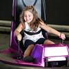 DAVID LE/Staff photo. Five-year-old Emma Rossetti smiles happily while bumping into her mother, Alexis, while on the bumper cars at the Salem Willows Arcade on Monday afternoon. 7/25/16.