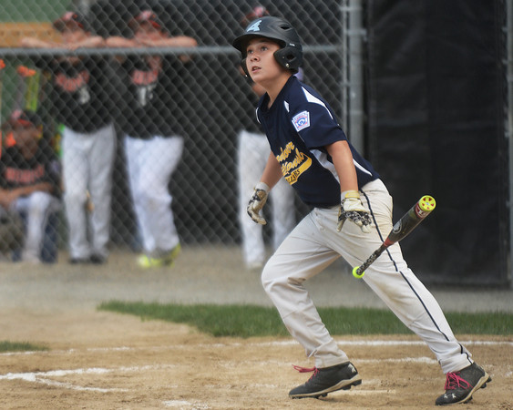 CARL RUSSO/Staff photo. Andover National Tyler Walles hits the first home run of the game for Andover. Andover defeated Woburn 16-6 in Little League action. 7/20/2016
