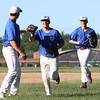 DAVID LE/Staff photo. Middleton-Peabody shortstop Jake Zeuli, center, gets a high five from teammate Kyle Kowalski, left, after he threw out a Newburyport runner. 7/19/16.