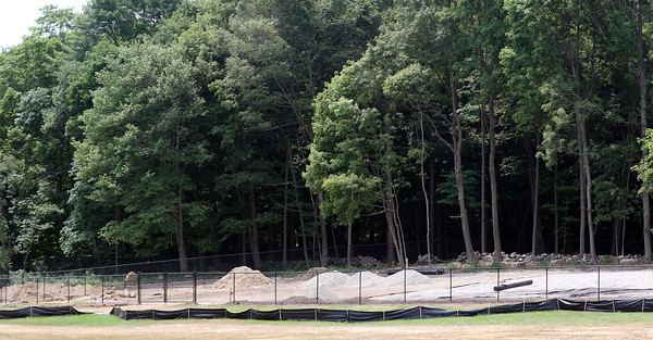 DAVID LE/Staff photo. The unfinished Danvers Dog Park sits next to the overflow parking lot of Endicott Park on Forest Street. 7/25/16.