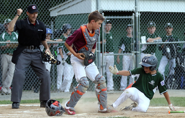 DAVID LE/Staff photo. Gloucester catcher Jared Lucido, left, records a force out on Manchester-Essex's AJ Pallazola as he slides into home plate on Tuesday evening at Harry Ball Field. 7/12/16.