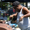 DAVID LE/Staff photo. James Freeman, of Dorchester, barbecues some ribs and chicken at the annual Black Picnic held at the Salem Willows on Saturday morning. 7/16/16.