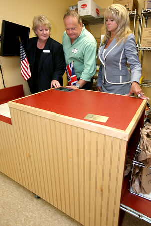 KEN YUSZKUS/Staff photo.  From left, Open Door executive director Julie LaFontaine, Ipswich East Rotary from the UK past president Mark Murphy, and Rotary Club of Ipswich, MA, president Lisa Shanko look over the new counter donated by the Ipswich East Rotary from the UK.      07/07/16