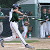 DAVID LE/Staff photo. Manchester-Essex's Kellan Heney lines a deep RBI double against Gloucester in the District 15 loser's bracket final on Tuesday evening at Harry Ball Field. 7/12/16.