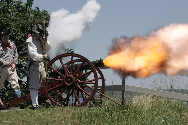KEN YUSZKUS/Staff photo.  Glover's Regiment celebrates the 4th of July at Fort Sewall by firing the regimental cannon in commemoration of the 13 original colonies and the members of the regiment who've passed on.  07/04/16.