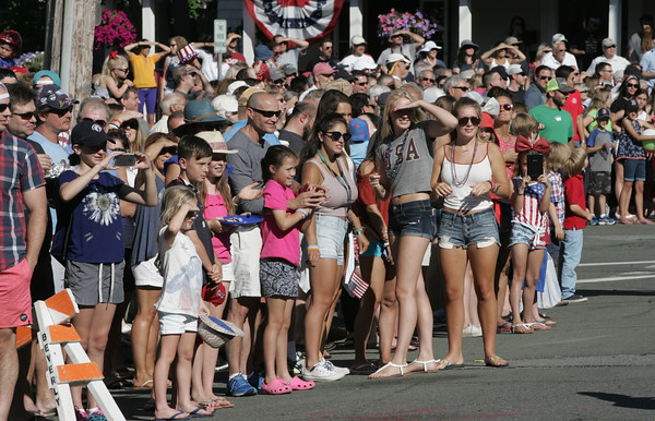 KEN YUSZKUS/Staff photo.  The crowds of people watch the Beverly Farms Horribles Parade.   07/04/16