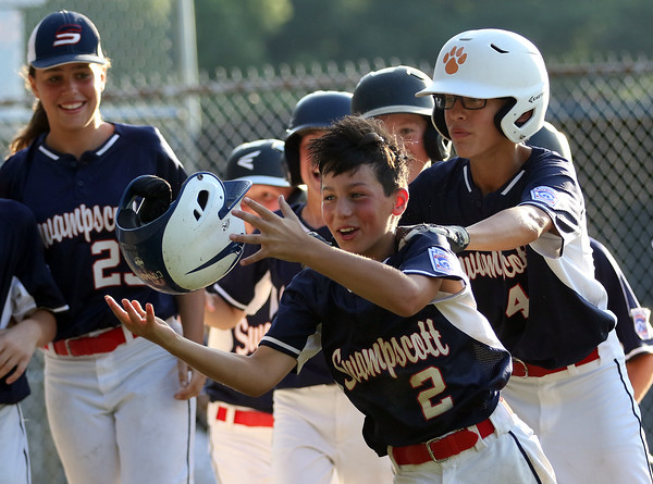 DAVID LE/Staff photo. Swampscott's Connor Correnti (2) happily skips back to the dugout while flipping off his helmet following his 3-run homer against Peabody West. 7/15/16.