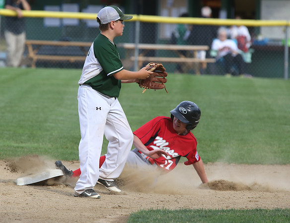 KEN YUSZKUS/Staff photo.  Boxford-Topsfield's Nick Cantalupo slides into 2nd with Manchester Essex's Trip Graves waiting for the throw during the Boxford-Topsfield vs. Manchester Essex Little League playoff game at Harry Ball Field in Beverly.    07/11/16