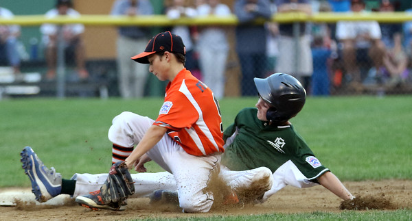 DAVID LE/Staff photo. Manchester-Essex's Kellan Heney slides safely into second base on a steal against Beverly in the District 15 Final on Thursday evening. 7/14/16.