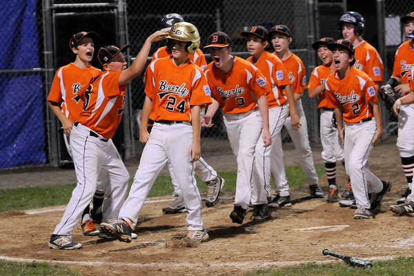 TIM JEAN/Staff photo<br /> Beverly players congratulate Joe Kotwicki after he hit a home run against Andover during the Section 4 Little League all-star championship game.  7/23/16