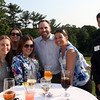 DAVID LE/Staff photo. From left, Jackie Logue, Samantha Bevilacqua, Krista Marchand, Taryne Rudenauer, Aaron Currier, and Michelle Macera, of DoubleTree by Hilton Boston North Shore, and Anthony Iantosca, of Tristar Worldwide, right, at an after hours networking event held at the Salem Country Club in Peabody by the North Shore Chamber of Commerce. 7/20/16.