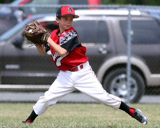 DAVID LE/Staff photo. Amesbury second baseman Sean Celona fires over to first to throw out a runner after making a nice sliding stop. 7/2/16.
