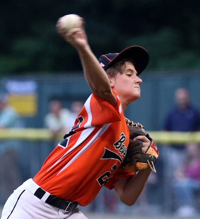 DAVID LE/Staff photo. Beverly starting pitcher Joe Kotwicki fires a pitch against Manchester-Essex in the District 15 Final. Kotwicki earned the win and Brennan Frost came in to record the save. 7/14/16.