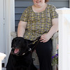 DAVID LE/Staff photo. Kayla Bentas, a 2009 graduate of Peabody Veterans Memorial High School, with her sight dog Haiku, a black labrador. Bentas is a member of the new Peabody Disabilities Commission, an idea that she pitched to Mayor Ted Bettencour. 7/12/16.