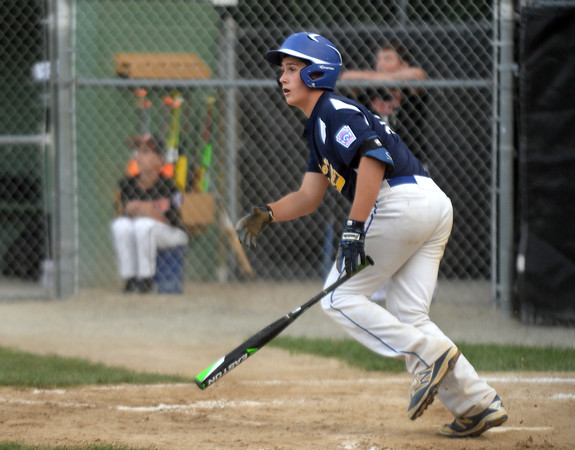 CARL RUSSO/Staff photo. Andover National, Kyle Wolff hits a grand slam in Little League action against Woburn. Andover defeated Woburn 16-6. 7/20/2016