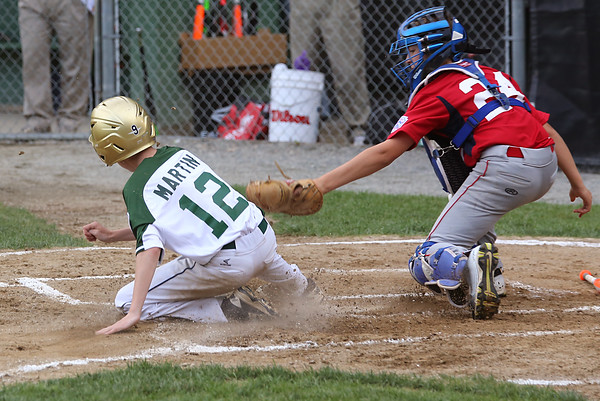 KEN YUSZKUS/Staff photo.   Manchester Essex's Peter Martin slides safely home as Boxford-Topsfield's Erik Sibbach tries to tag him during the Boxford-Topsfield vs. Manchester Essex Little League playoff game at Harry Ball Field in Beverly.    07/11/16
