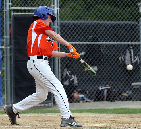 DAVID LE/Staff photo. Beverly's Brennan Frost lines a RBI single just inside the first base bag to drive in teammate Joe Loreti with the eventual game-winning run. 7/8/16.