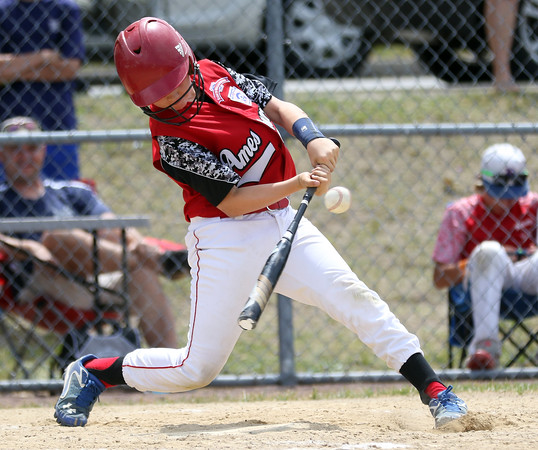 DAVID LE/Staff photo. Amesbury catcher Peyton McKee lines a hit to drive in a run against Danvers National on Saturday afternoon. 7/2/16.