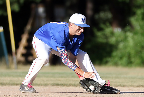 DAVID LE/Staff photo. Middleton-Peabody second baseman Jack Connors fields a ball and fires to first to retire a Newburyport runner. 7/19/16.