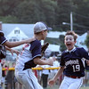 DAVID LE/Staff photo. Swampscott's Nathan DeRoche, right, runs excitedly to greet battery mates Connor Correnti, left, and Mathew Schroeder, center, after the Big Blue defeated Peabody West 10-7 in the District 16 Championship. 7/15/16.