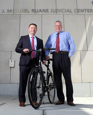 DAVID LE/Staff photo. Patrick Collins, right, an assistant court magistrate at Salem Superior Court, and lawyer Thomas Burke, will be part of a team for the Pan Mass Challenge in tribute to the late Judge Michael Lauranzano, a longtime judge from Beverly who passed away from brain cancer last year. 7/26/16.