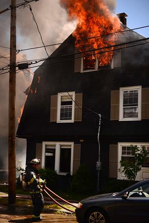 PAUL BILODEAU/Staff photo. Firefighters battle a fast moving, multi-alarm fire on Bay View Drive in Swampscott.