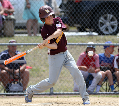 DAVID LE/Staff photo. Danvers National cleanup hitter Cameron Wodarski lines a double against Amesbury. 7/2/16.